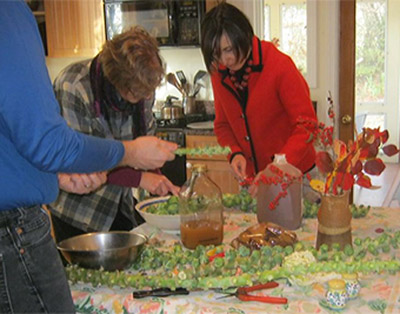 Mike, Melanie and Sophia prep the sprouts